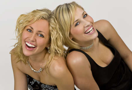 Studio shot of a two beautiful young blond women dressed upand having fun Stock Photo