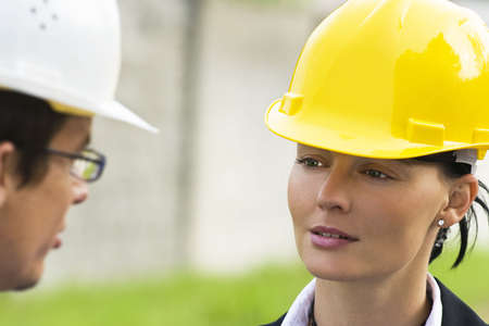 construction safety: Young male and female managers working together in an industrial situation  Stock Photo