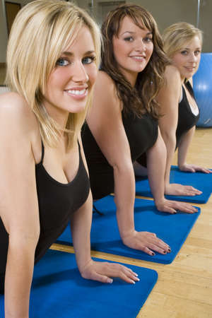 Three beautiful young women stretching at the gym Stock Photo - 2827498
