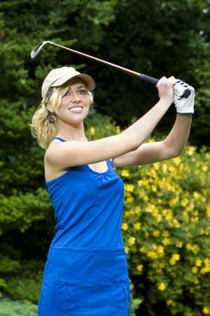 woman golf: A beautiful blond haired blue eyed young woman playing golf
