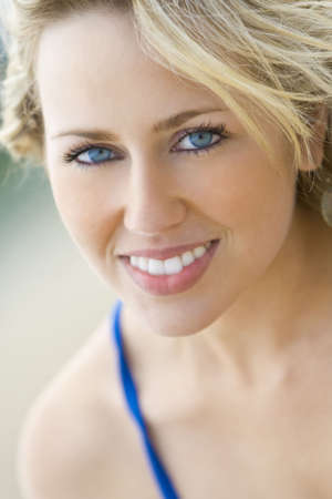 A beautiful blond haired blue eyed model with a gorgeous smile shot in close up with a short depth of field and illuminated with natural light Stock Photo - 3187299