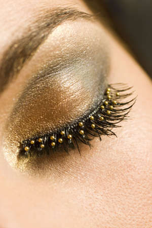 A macro close up of a beautiful womans made up eye with false eyelashes