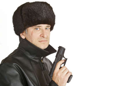 A russian mafia figure with a large facial scar carrying a hand gun, picture shot on a white background with copy space Stock Photo - 3469822