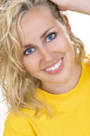 Studio shot of a beautiful blond haired blue eyed female model Stock Photo