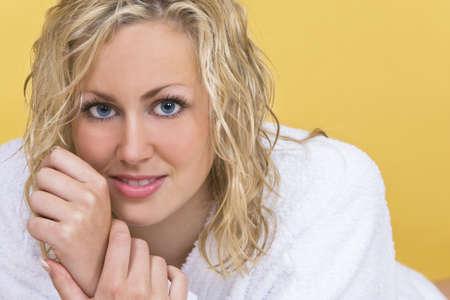 bath robe: A stunningly beautiful young blond woman wearing a bath robe  Stock Photo