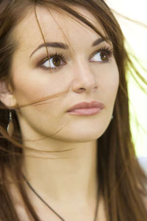 windswept: Natural portrait of a beautiful brunette with windswept hair