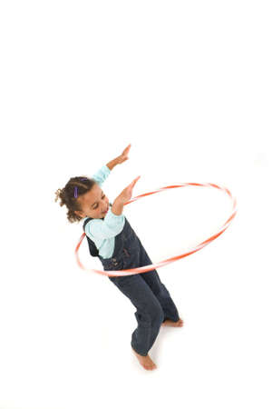Studio shot of a beautiful young mixed race girl using a hula hoop Stock Photo