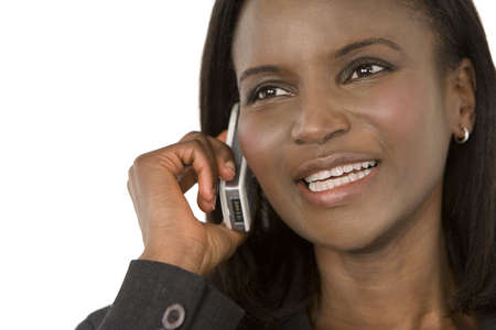 An African American businesswoman chatting on her mobile phone photo