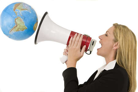 A businesswoman shouting at the world through a megaphone photo