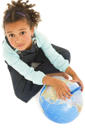 looking upwards: Environmental concept studio shot of a beautiful young mixed race girl with a globe looking upwards wondering what is going to happen next to planet earth. Isolated with a shadow for depth.