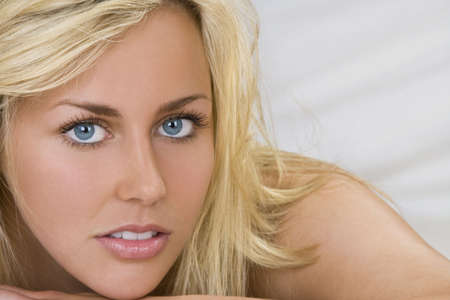 blonde blue eyes: Close up studio portrait of a beautiful blond haired blue eyed young woman  Stock Photo