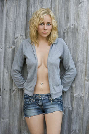 hooded top: A beautiful blond haired blue eyed young woman looking sexy in denim shorts and a hooded top