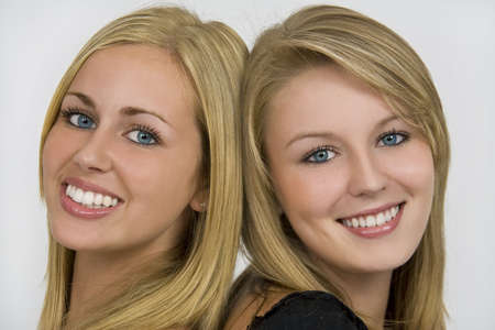 Two beautiful young women with beautiful blue eyes and lovely toothy smiles