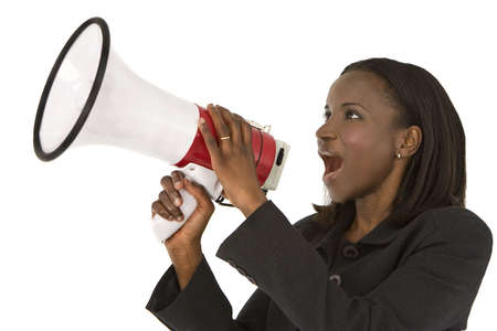 businesswoman suit: Un African American gritos de negocios a trav�s de un meg�fono Foto de archivo