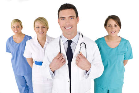 A male doctor with his team of colleagues out of focus behind him.