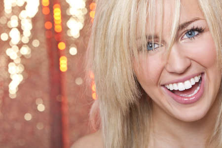 Studio shot of a stunningly beautiful young blond woman shot with a sparkling red background Stock Photo - 4303848