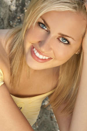 A beautiful blond haired blue eyed model illuminated by golden sunlight Stock Photo - 4625717