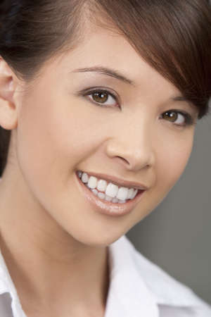 toothy: A beautiful young oriental woman with a wonderful toothy smile