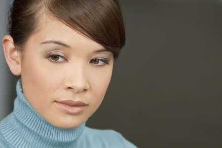 Studio portrait of a beautiful young oriental woman Stock Photo - 4799777