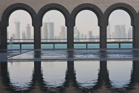 The Doha skyline shot through traditional arches from inside the Museum of Islamic Art, Qatar December 2008