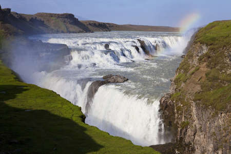 A rainbow over Gullfoss waterfall on the Hvita River in southwest Iceland photo