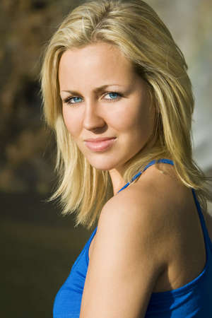 blue eyed: A beautiful blond haired blue eyed model photographed in golden evening sunlight Stock Photo