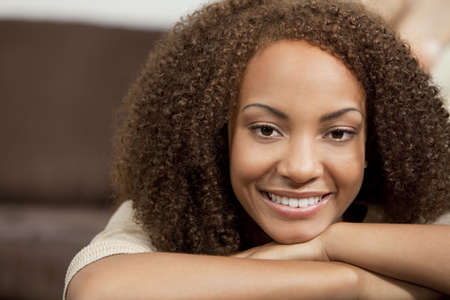 perfect smile: A beautiful miced race African American girl laying down with perfect teeth and smile