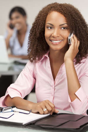 A stunningly beautiful young mixed race African American woman talking happily on her cell phone Stock Photo - 5643204