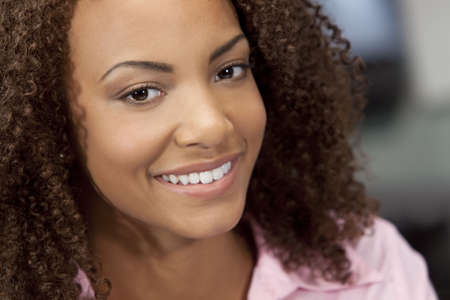 A beautiful mixed race African American girl with perfect teeth and smile Stock Photo - 5646546