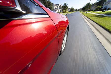 Slow shutter speed mounted camera shot taken from a car driving at speed through a suburban neighborhood. Stock Photo - 5840619