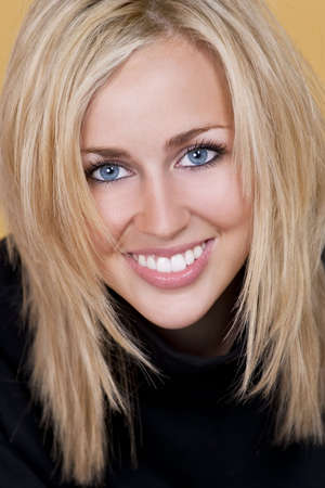 Studio shot of a beautiful happy blond haired blue eyed woman with perfect teeth and smile Stock Photo - 5944625
