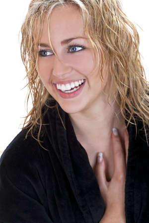 Studio shot of a young happy beautiful blond haired blue eyed female model laughing with perfect teeth photo