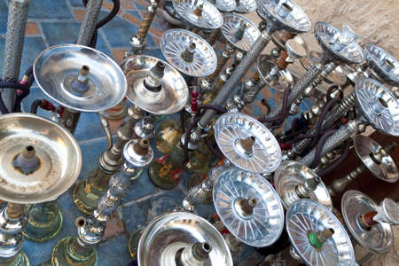 Arabic shisha, sometimes called hookah, waterpipes lined up on a the floor for customers in a restaurant in an Arabic country. Stock Photo - 6336214