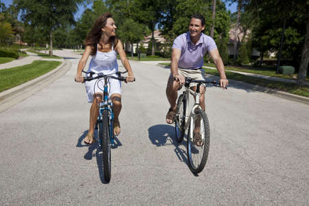 Two attractive adults, man and woman couple, cycling together. Stock Photo - 7110095