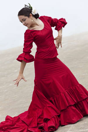 spanish dancer: Woman traditional Spanish Flamenco dancer dancing in a red dress