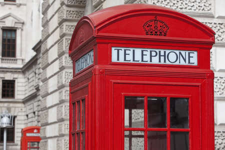 Two classic red London Telephone boxes, in the City of Westminster, London, England, Great Britain