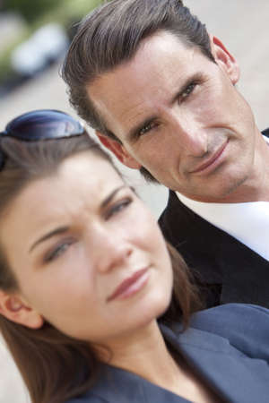 An outdoor portrait of handsome middle aged man and beautiful young woman couple, the focus is on the man in the background photo
