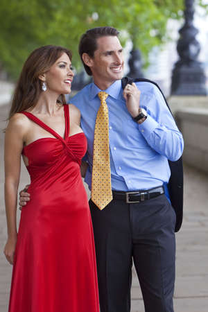 Romantic man and woman couple walking by the River Thames in London, England, Great Britain photo