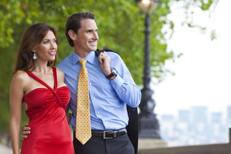 Romantic man and woman couple by the RIver Thames in London, England, Great Britain, Europe