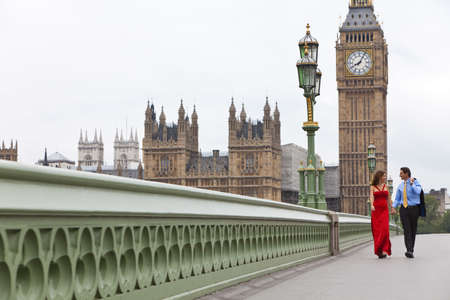 Romantic man and woman couple on Westminster Bridge with Big Ben in the background, London, England, Great Britain photo