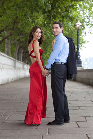 Romantic man and woman couple holding hands in London, England, Great Britain photo