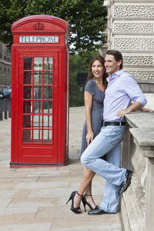 Romantic man and woman couple next to traditional red telephone box in Westminster, London, England, Great Britain Stock Photo - 8329883