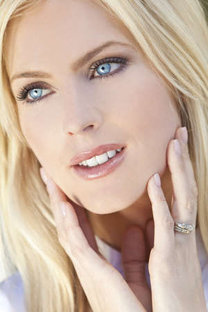 Natural light portrait of a beautiful blond woman with blue eyes