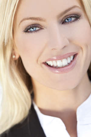 Natural light portrait of a beautiful smiling blond woman with blue eyes Stock Photo - 8955216