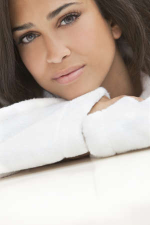 Portrait of a beautiful healthy young brunette woman in a white spa bath robe Stock Photo - 9150676