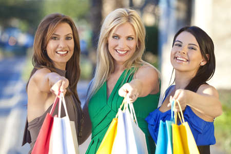 Three Beautiful and fashionable women with colorful shopping bags Stock Photo - 9247032