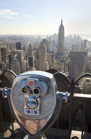 Tourist binoculars overlooking the Manhattan skyline in New York City, USA, United States of America photo