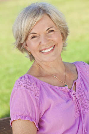 An attractive elegant smiling senior woman