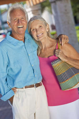 Happy senior man and woman couple together outside in sunshine Stock Photo - 9383941