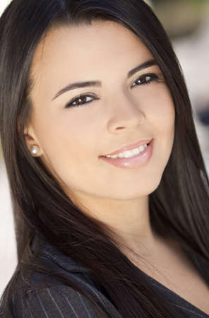 latina girl: Outdoor portrait of a beautiful young Latina Hispanic woman or businesswoman smiling